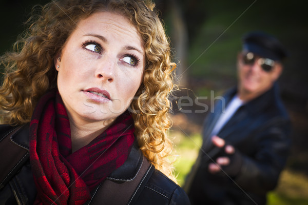Pretty Young Teen Girl with Man Lurking Behind Her Stock photo © feverpitch