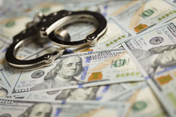 Handcuffs and Newly Designed One Hundred Dollar Bills Stock photo © feverpitch