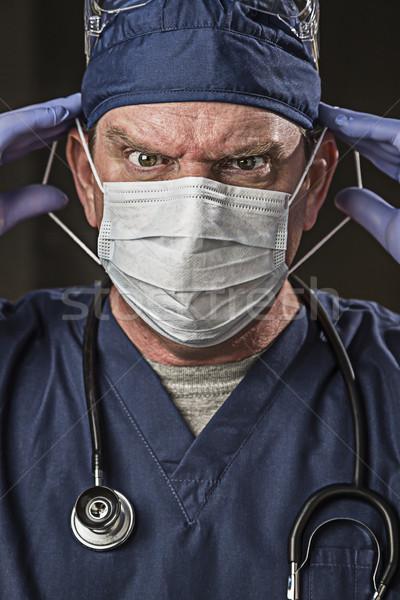 определенный глядя врач медсестры носить мужской доктор Сток-фото © feverpitch