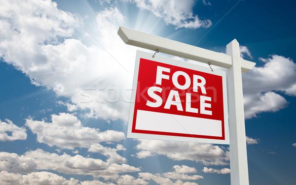 Satış gayrimenkul imzalamak bulutlar mavi gökyüzü güneş Stok fotoğraf © feverpitch