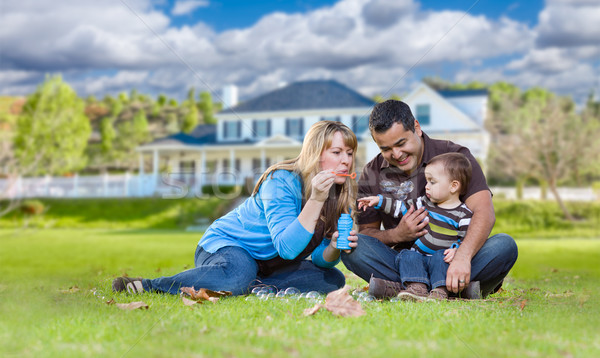 Happy Mixed Race Ethnic Family Playing with Bubbles In Front Yar Stock photo © feverpitch