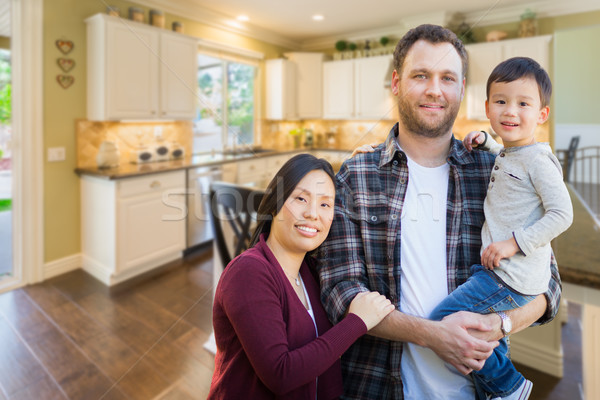 Mixed Race Chinese and Caucasian Parents and Child Indoors Insid Stock photo © feverpitch