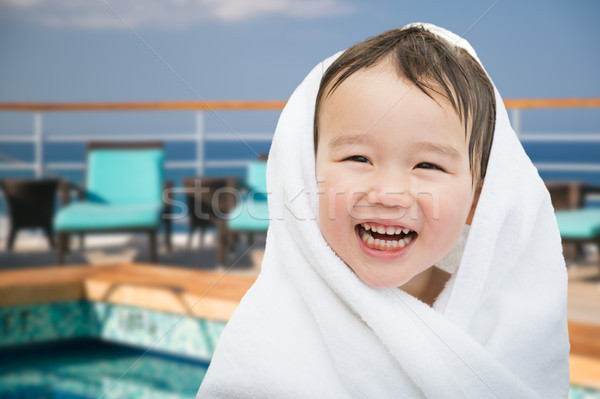 Happy Cute Mixed Race Chinese and Caucasian Boy On Cruise Ship W Stock photo © feverpitch