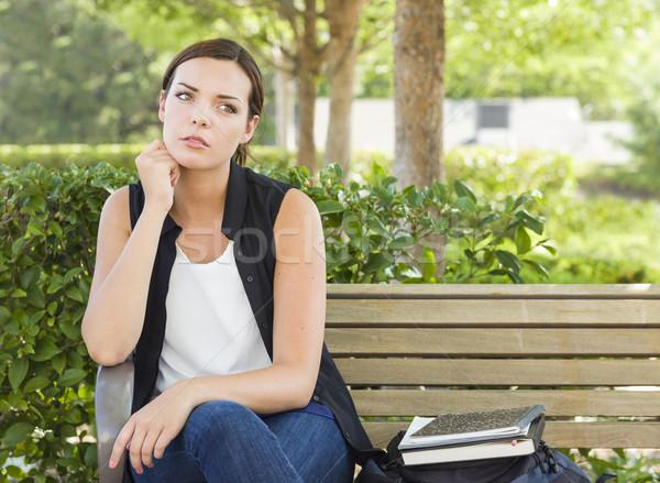 Melancolia mulher sessão banco livros Foto stock © feverpitch