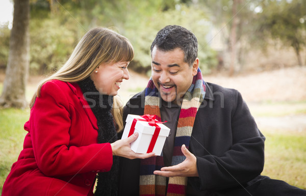 Mixed Race Couple Sharing Christmas or Valentines Day Gift Outsi Stock photo © feverpitch