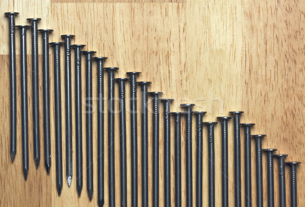 Declining Graph of Nails Stock photo © feverpitch