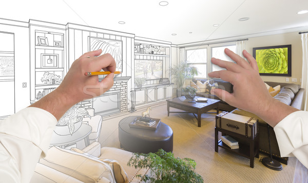 Stock photo: Hands Drawing Living Room Design Gradating Into Photograph