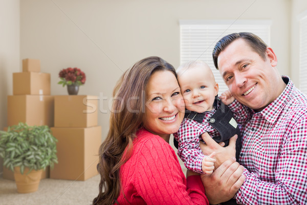 Caucasian Family with Baby In Room with Moving Boxes Stock photo © feverpitch