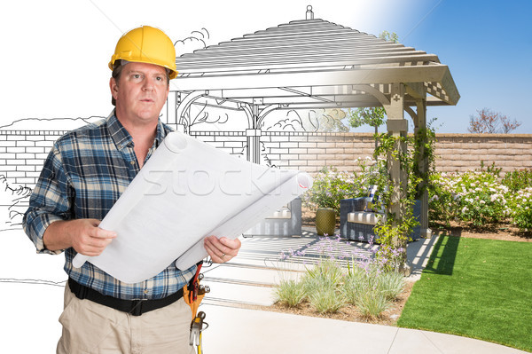 Male Contractor With House Plans Wearing Hard Hat In Front of Cu Stock photo © feverpitch