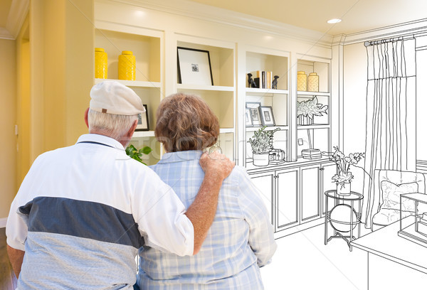 Senior Couple Facing Custom Built-in Shelves and Cabinets Design Stock photo © feverpitch