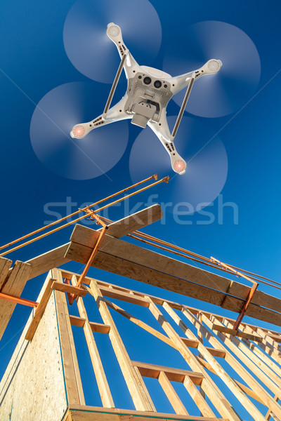Drone Quadcopter Flying and Inspecting Construction Site Stock photo © feverpitch