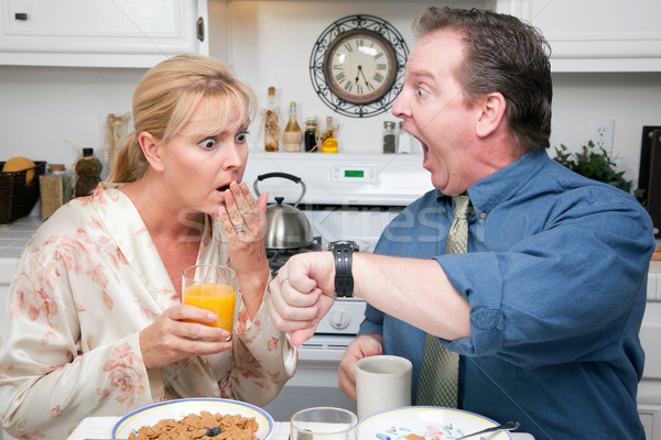 Stressed Couple in Kitchen Late for Work Stock photo © feverpitch