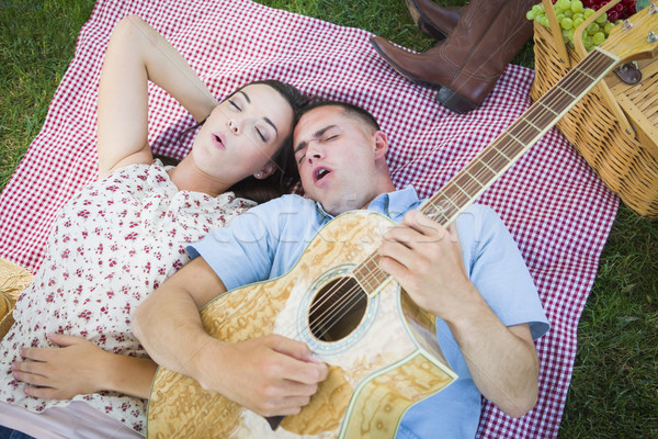 Mixed Race Couple at the Park Playing Guitar and Singing Stock photo © feverpitch