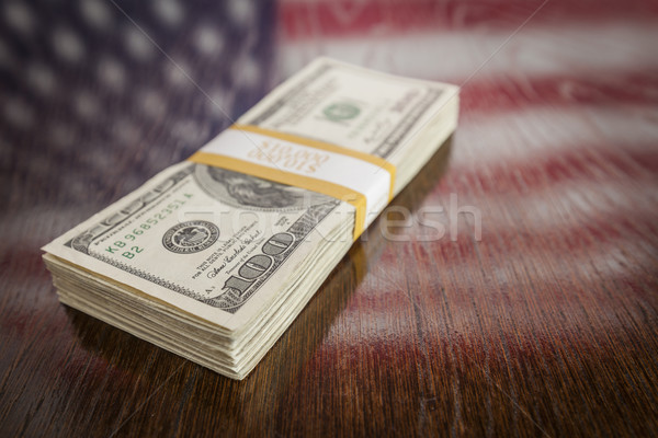 Thousands of Dollars with Reflection of American Flag on Table Stock photo © feverpitch