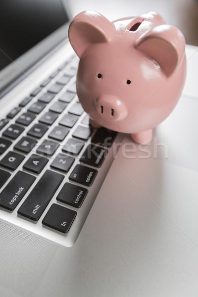Piggy Bank портативного компьютера клавиатура компьютер торговых Сток-фото © feverpitch