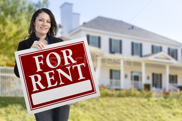 Hispanic Female Holding For Rent Sign In Front of House Stock photo © feverpitch