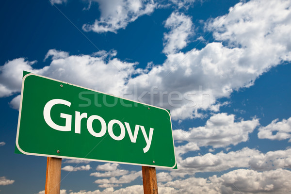 Groovy Green Road Sign with Sky Stock photo © feverpitch