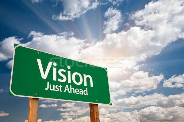 Vision Green Road Sign Over Clouds Stock photo © feverpitch