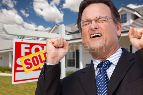 Excited Man in Front of Sold Real Estate Sign and House Stock photo © feverpitch