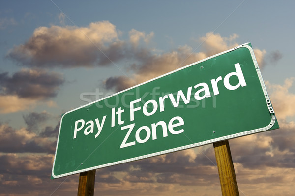 Pay It Forward Zone Green Road Sign and Clouds Stock photo © feverpitch