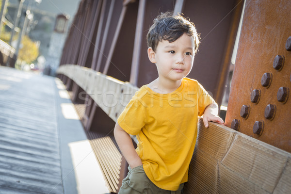 Mixed Race Boy Leaning on Bridge Outdoors Stock photo © feverpitch