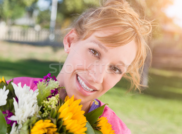 Outdoor Portrait of an Excited Young Adult Brown Eyed Woman Hold Stock photo © feverpitch