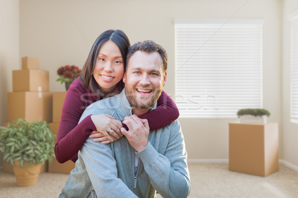 Mixed Race Caucasian and Chinese Couple Inside Empty Room with M Stock photo © feverpitch