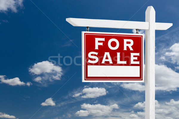Left Facing For Sale Real Estate Sign Over Blue Sky and Clouds W Stock photo © feverpitch