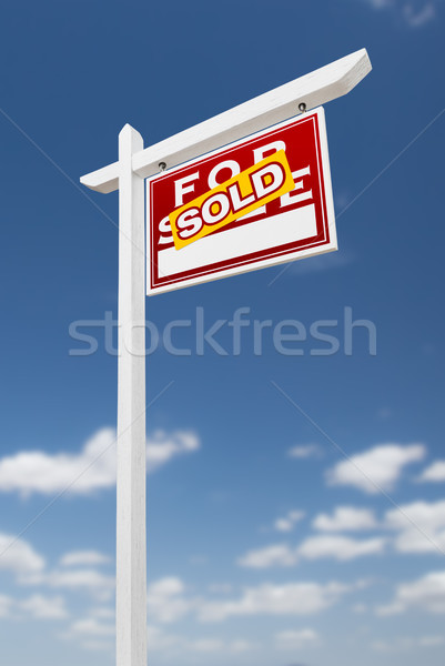 Right Facing Sold For Sale Real Estate Sign on a Blue Sky with C Stock photo © feverpitch