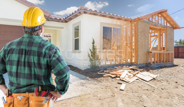 Contractor Standing Outside Construction Framing and Photo of Ne Stock photo © feverpitch