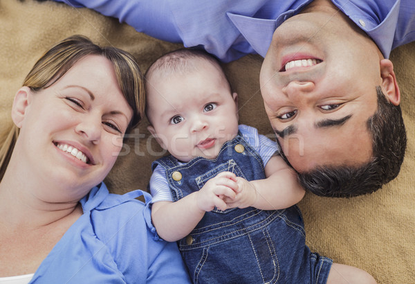 Stock photo: Mixed Race Family Playing on the Blanket