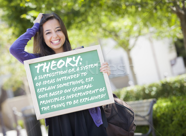 Mixed Race Female Student Holding Chalkboard With Theory and Def Stock photo © feverpitch