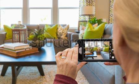 Stock photo: Young Couple Framing Hands of Home Interior