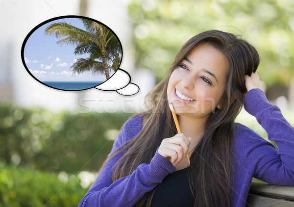 Pensive Woman with Tropical Scene Inside Thought Bubble Stock photo © feverpitch