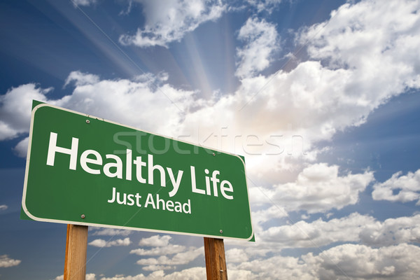 Healthy Life Green Road Sign Over Clouds Stock photo © feverpitch