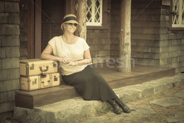 1920s Dressed Girl and Suitcases on Porch with Vintage Effect Stock photo © feverpitch