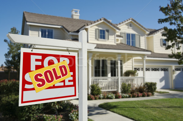 Sold Home For Sale Sign and House Stock photo © feverpitch