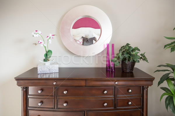 Beautiful Dresser and Mirror Against a Wall in a Home. Stock photo © feverpitch