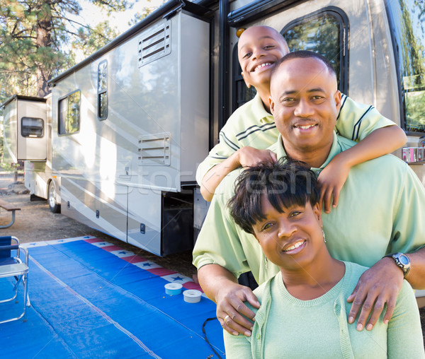 Happy African American Family In Front of Their Beautiful RV At  Stock photo © feverpitch