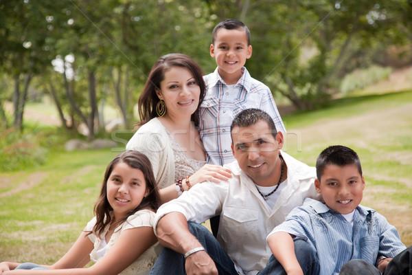 Happy Hispanic Family In the Park Stock photo © feverpitch