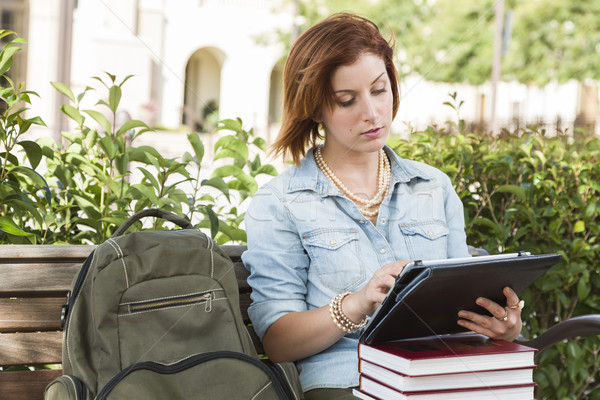 Stock photo: Young Female Student Outside on Bench Using Touch Tablet