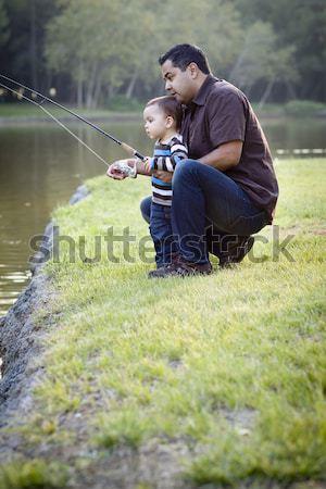 Szczęśliwy młodych etnicznych syn ojca połowów jezioro Zdjęcia stock © feverpitch