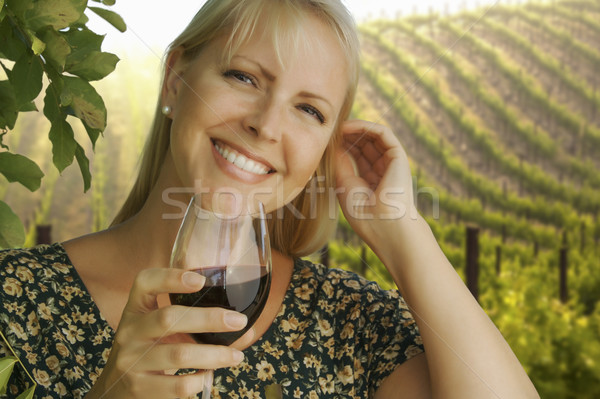 Attractive Woman Enjoying a Glass of Wine at the Vineyard Stock photo © feverpitch
