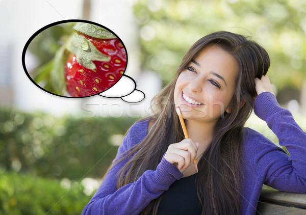 Pensativo mujer fresa dentro burbuja de pensamiento nutritivo Foto stock © feverpitch