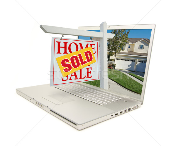 Sold Home for Sale Sign & New House on Laptop Stock photo © feverpitch