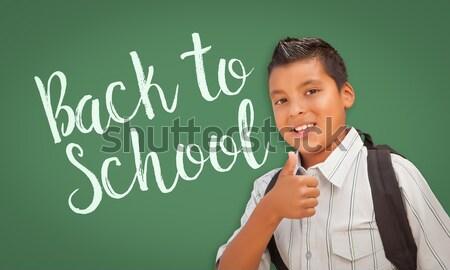 Cute Hispanic Boy In Front of Blank Chalk Board Stock photo © feverpitch