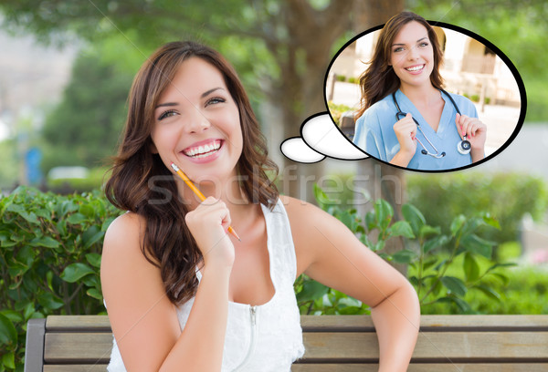 Nadenkend jonge vrouw arts verpleegkundige binnenkant gedachte bel Stockfoto © feverpitch