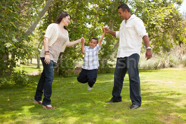 Young Hispanic Family Having Fun in the Park Stock photo © feverpitch