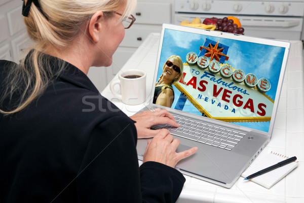 Woman In Kitchen Using Laptop - Las Vegas Stock photo © feverpitch