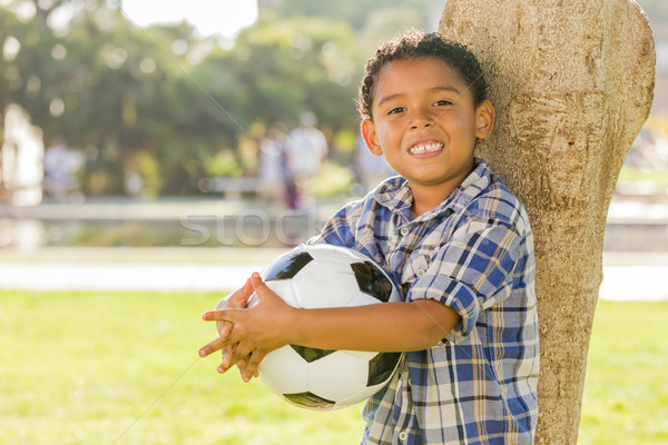 Mixed Race Boy Holding Soccer Ball in the Park Stock photo © feverpitch